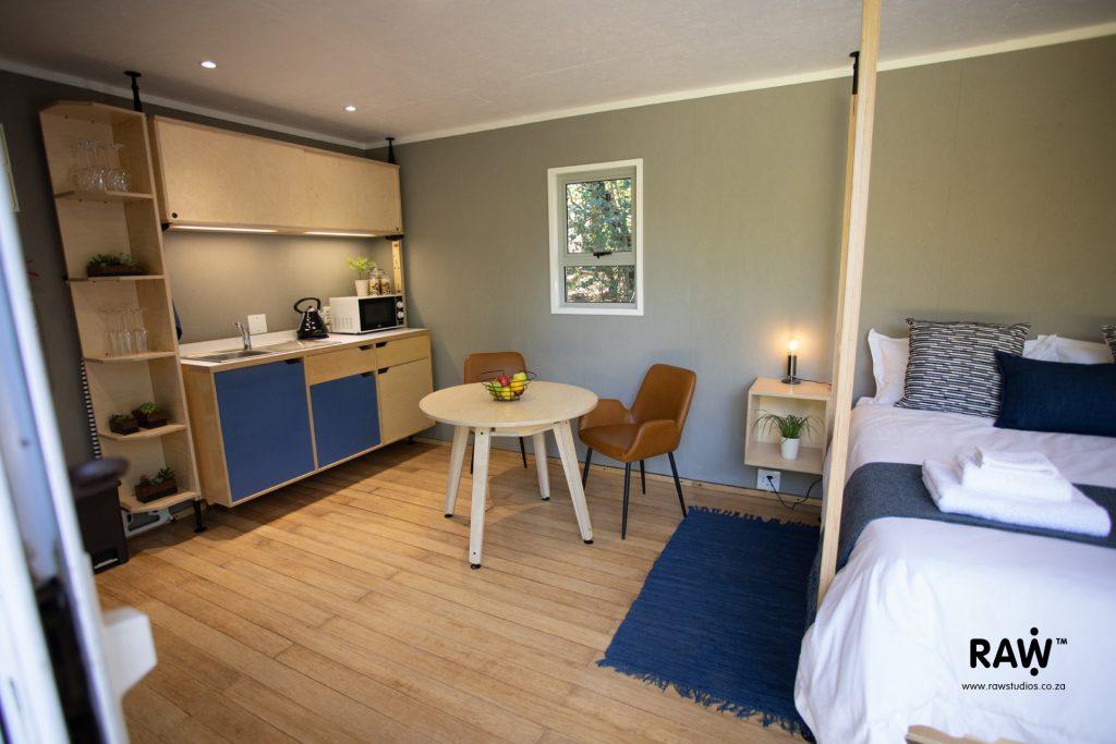 Zenkaya prefab living unit interior kitchen and dining furniture